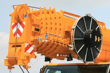 Double hose reel with spring drive on an all terrain mobile crane